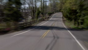 Driving Windy Road. V5. Zoomed in windy road time lapse in the hillsides in Portland stock video