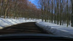 Driving a car, snowy landscape stock video footage