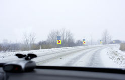 Driving on winter road Royalty Free Stock Images