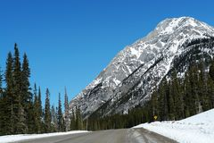 Driving in winter rockies Royalty Free Stock Photo