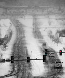 Driving in Winter Snow Storm on Streets in Town Stock Photo