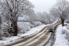 Driving in Winter snow - United Kingdom. Driving in winter snow on a country road in North Yorkshire in the United Kingdom stock image