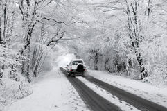 Driving through a winter wonderland. Driving through a snow covered winter wonderland tunnel along country lane Stock Images