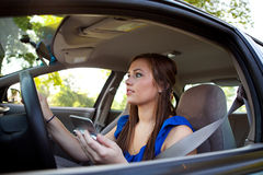 Driving: Woman Reading Directions Royalty Free Stock Photography