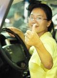 Driving woman thumb up Royalty Free Stock Image