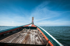 Driving a wooden boat in the sea Royalty Free Stock Photo