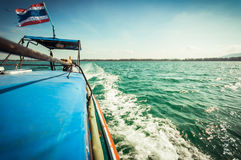 Driving a wooden boat in the sea Royalty Free Stock Photography