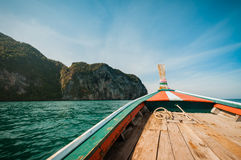 Driving a wooden boat in the sea Stock Images