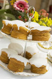 Drizzle Cakes. On a cake stand at a summer garden party Royalty Free Stock Photography