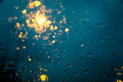 Drizzle on the windshield in the evening. stock photo
