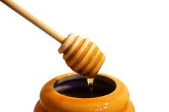 Drizzler de madera de la miel imagen de archivo