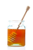Drizzler inside of honey jar Stock Photography