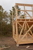 Drizzly autumn day at the construction site. Construction of a wooden house in the forest. Construction of the house. Stock Images