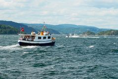 People enjoy boat trip by the fjord in Drobak, Norway. stock images