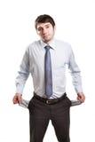 Droevig en brak zakenman met lege zakken Stock Afbeeldingen