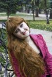 Droevig glimlachend meisje stock afbeelding