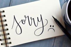 DROEVIG hand-van letters voorzien in blocnote stock fotografie