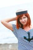Droevig meisje in het vest van de zeeman stock fotografie