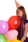 Droevig meisje met gekleurd baloons Stock Foto