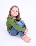 Droevig meisje op wit stock afbeelding
