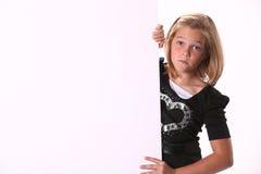 Droevig Meisje Preteen die een Teken houdt Stock Fotografie