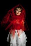 Droevig meisje in rood Stock Foto's