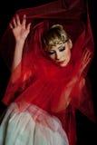 Droevig meisje in rood Stock Afbeelding