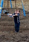 Droevig weinig jongen bij de speelplaats Royalty-vrije Stock Afbeelding