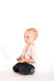 Droevige baby met telefoon Stock Afbeelding