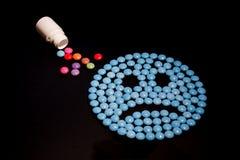 Droevige blauwe emoticon Stock Foto's