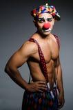 Droevige clown tegen Royalty-vrije Stock Afbeeldingen