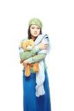 Droevige dame met stuk speelgoed stock fotografie