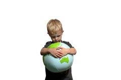Droevige jongen die Wereld koestert Royalty-vrije Stock Afbeelding