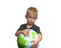 Droevige jongenspunten aan wereld Royalty-vrije Stock Afbeeldingen