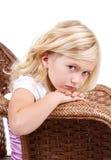 Droevige meisjeszitting als voorzitter royalty-vrije stock foto