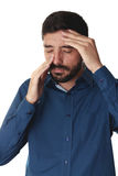 Droevige mens die zijn neus houden omdat sinuspijn Royalty-vrije Stock Afbeelding