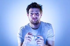 Droevige Mens met Gamepad Stock Foto's