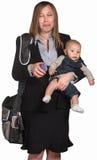 Droevige Professionele Vrouw met Baby Royalty-vrije Stock Afbeelding