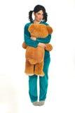 Droevige vrouw die grote teddybeer houdt stock afbeeldingen