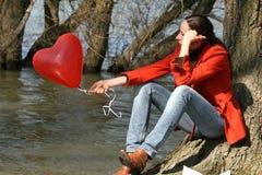 Droevige vrouw met ballon Stock Foto's