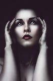 Droevige vrouw met hoofdpijn Stock Fotografie