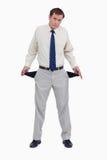 Droevige zakenman die zijn lege zakken toont Royalty-vrije Stock Foto