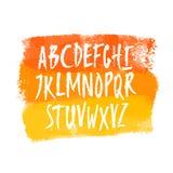 Drog uppercase bokstäver för vektor hand på vattenfärgbakgrund arkivfoton
