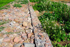 Droga brukująca z kamieniem, drogi tłem i abstraktem, Fotografia Stock