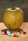 Droga e maçã Foto de Stock