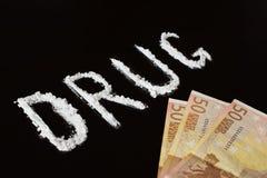 Droga e soldi del testo Immagine Stock