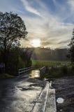 Droga meandruje w odległość podczas deszczu Fotografia Stock