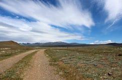 Droga z chmurami Zdjęcia Stock