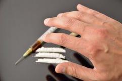 Drogadicto con las drogas Foto de archivo