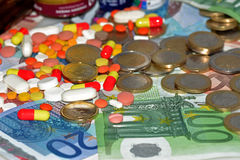 Drogas, píldoras y dinero Imagenes de archivo